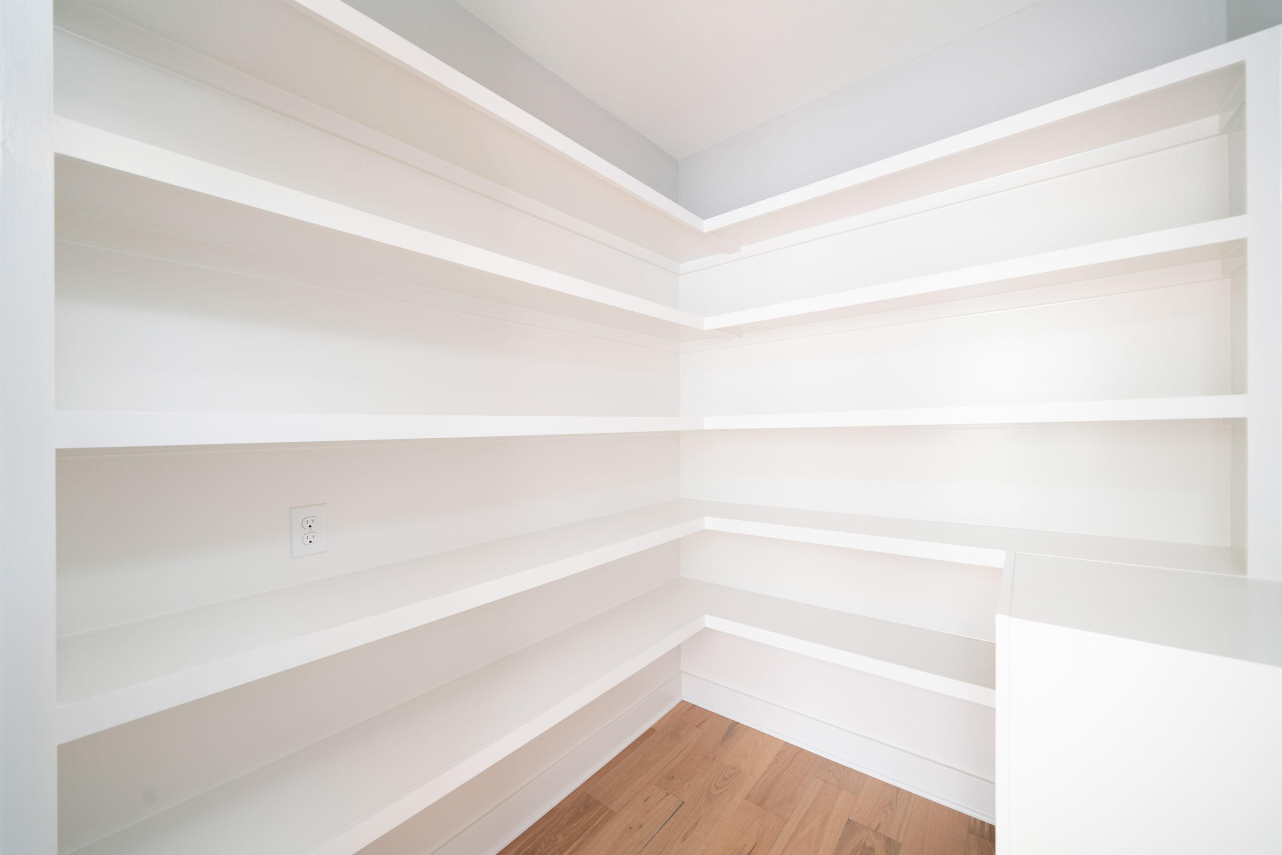 custom white painted wood pantry shelving
