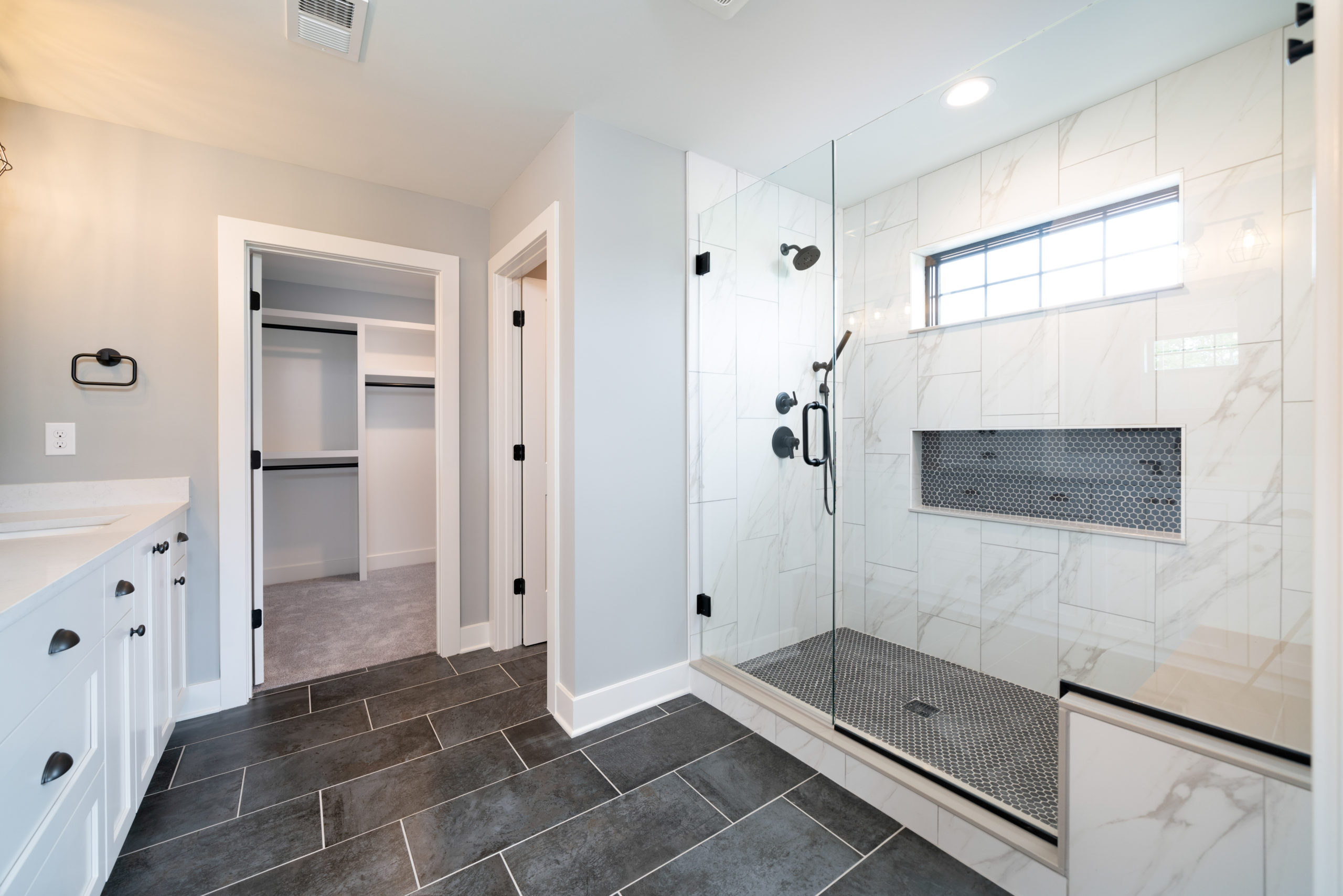 master bathroom with large shower with bench