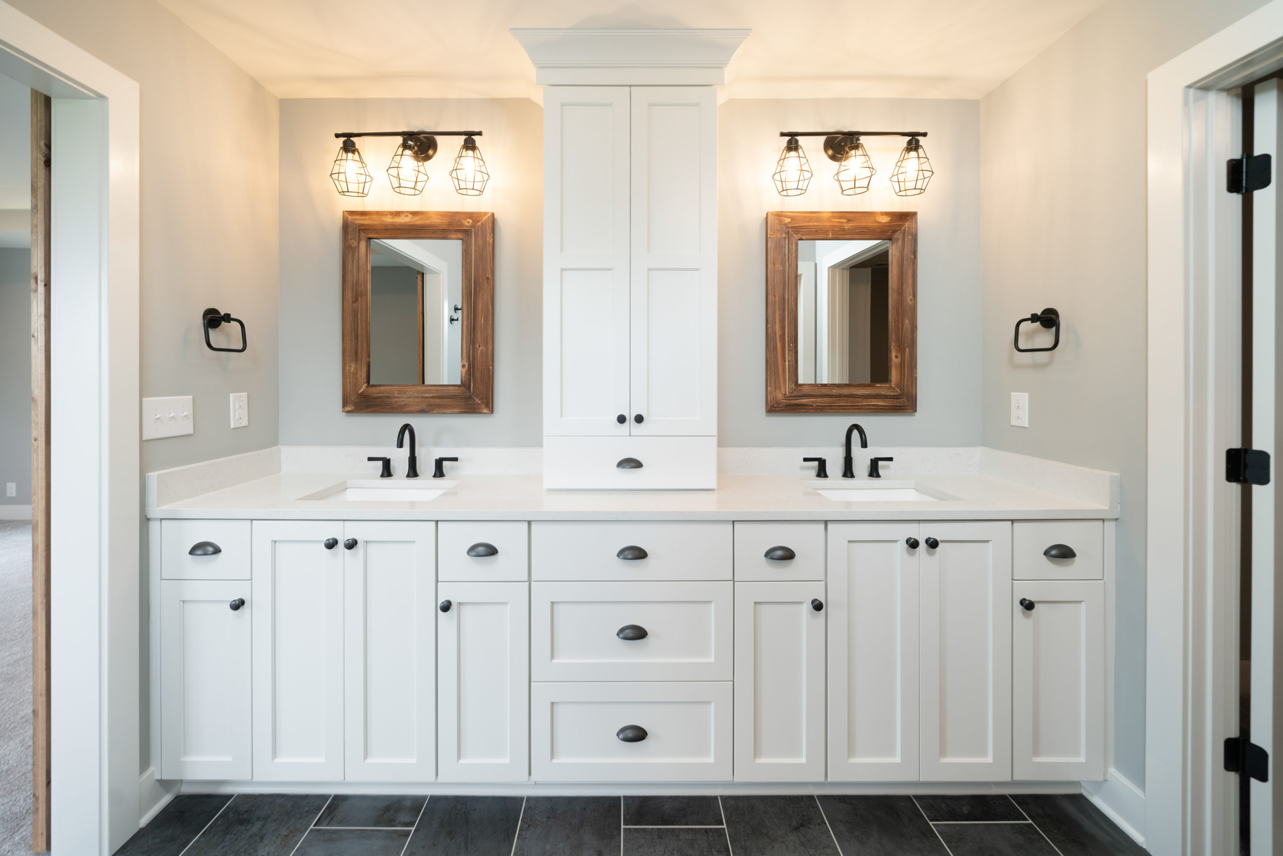 double master vanity white cabinets and black hardware