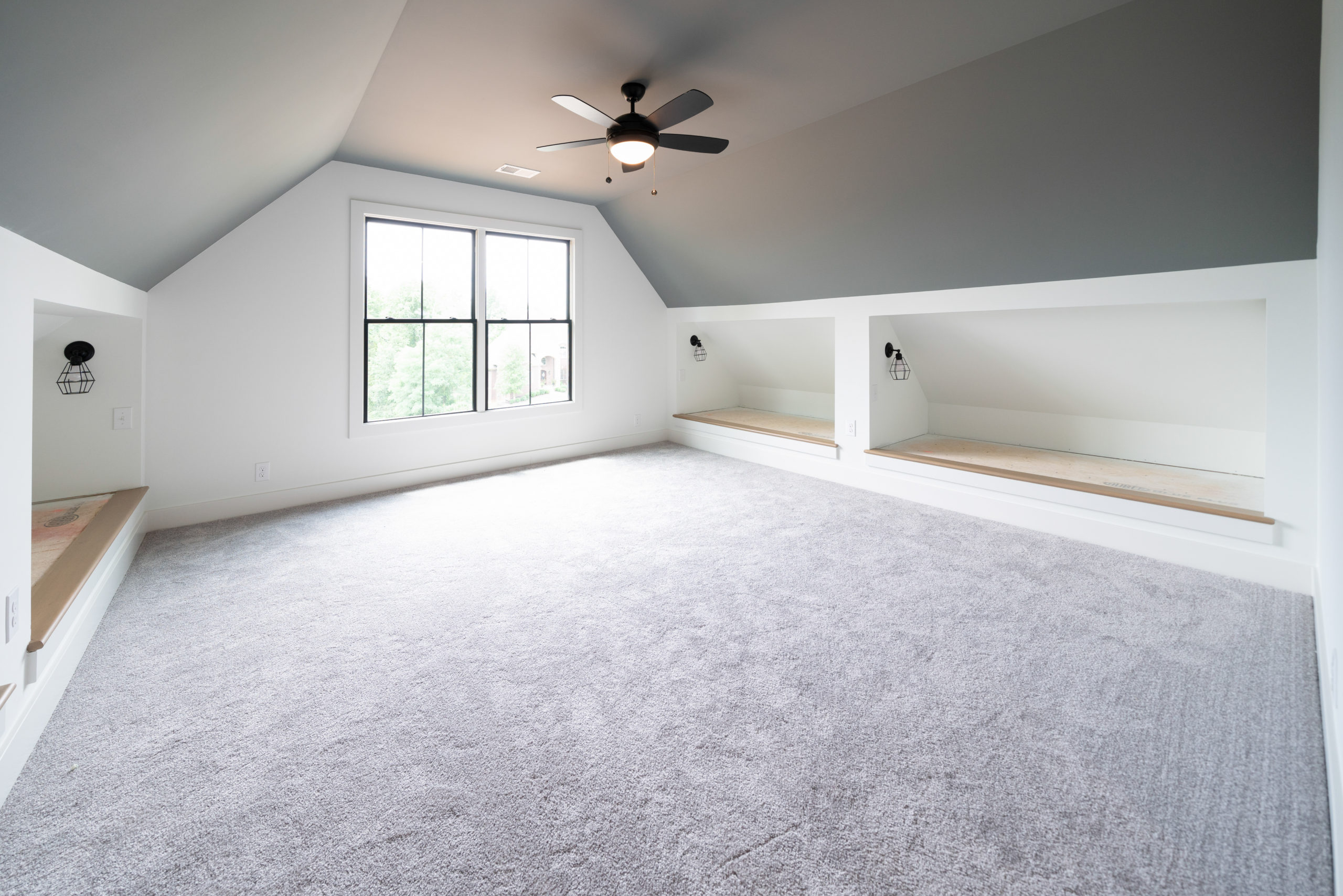 vaulted ceiling bonus room with custom built benches