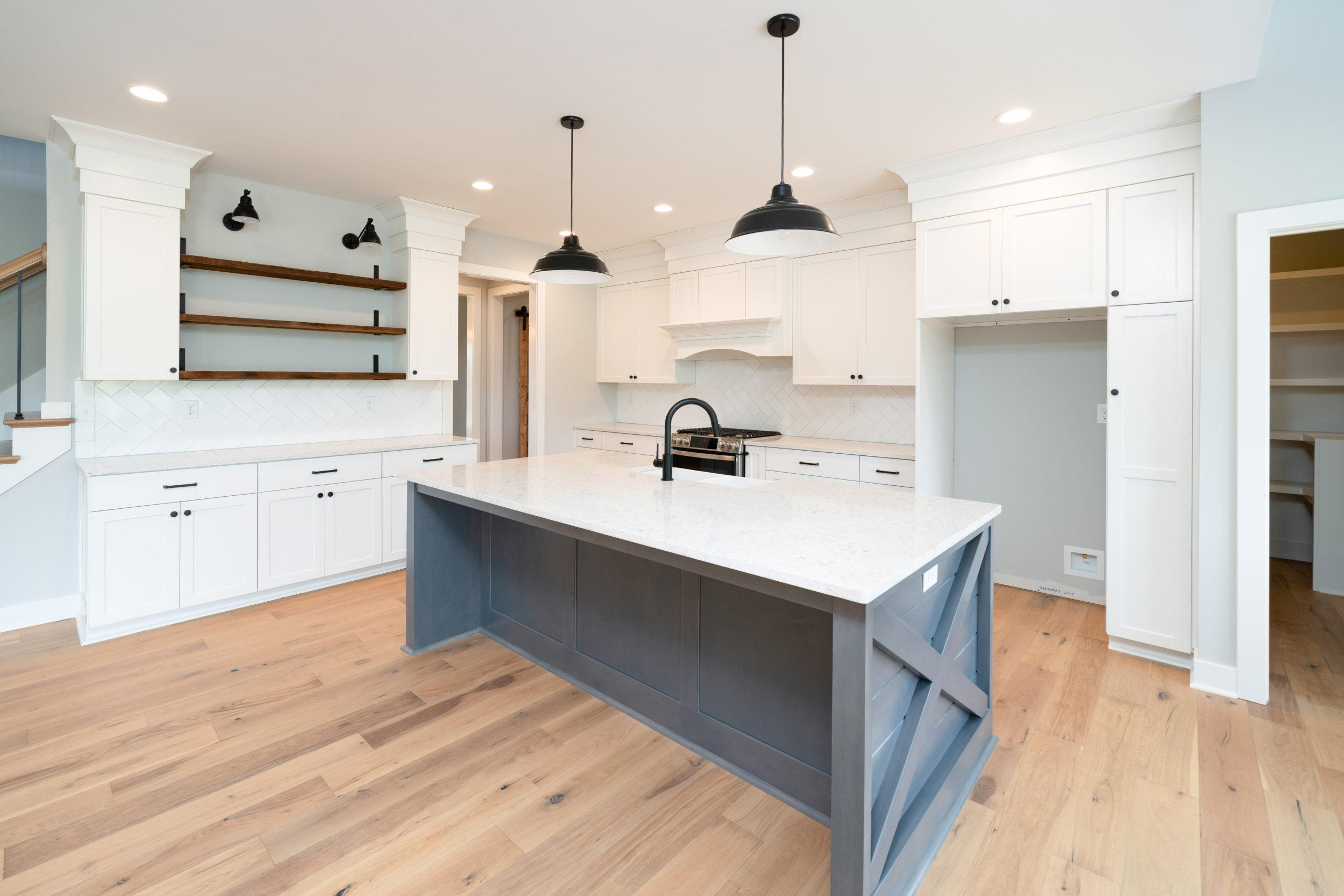 Large Gray Island in farmhouse kitchen