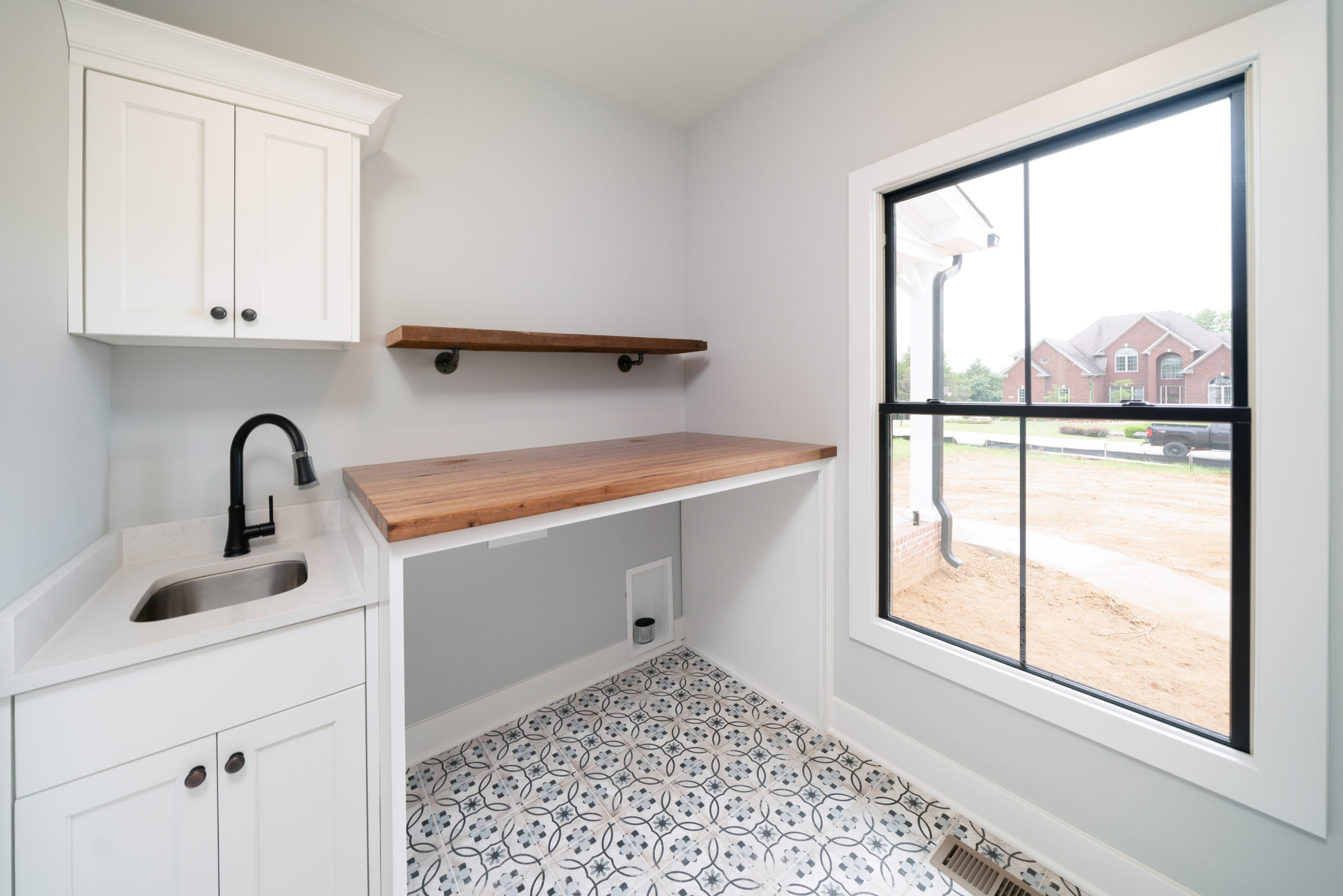 farmhouse laundry room with folding table and sink