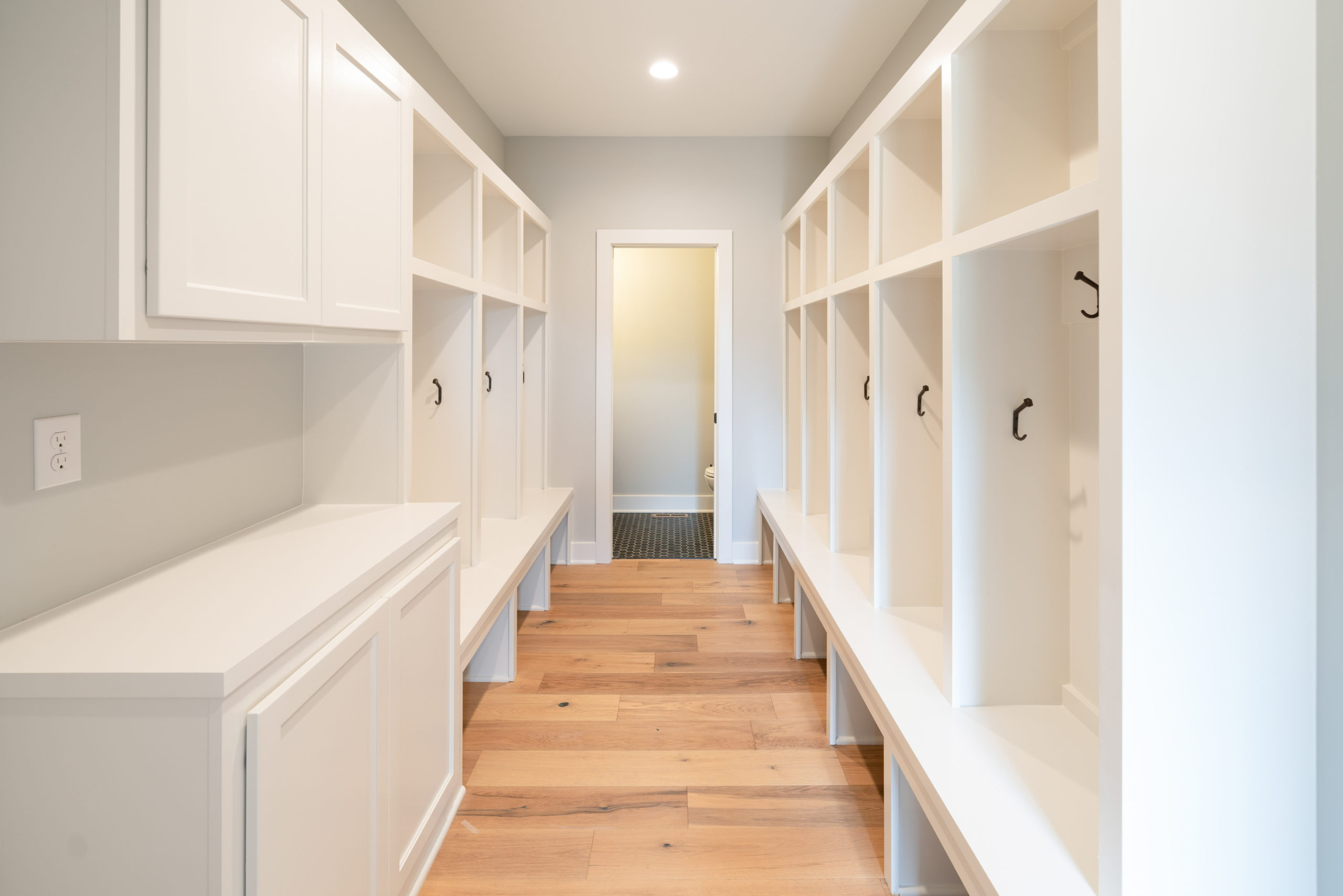 mudroom with cubbies and hardwood floors