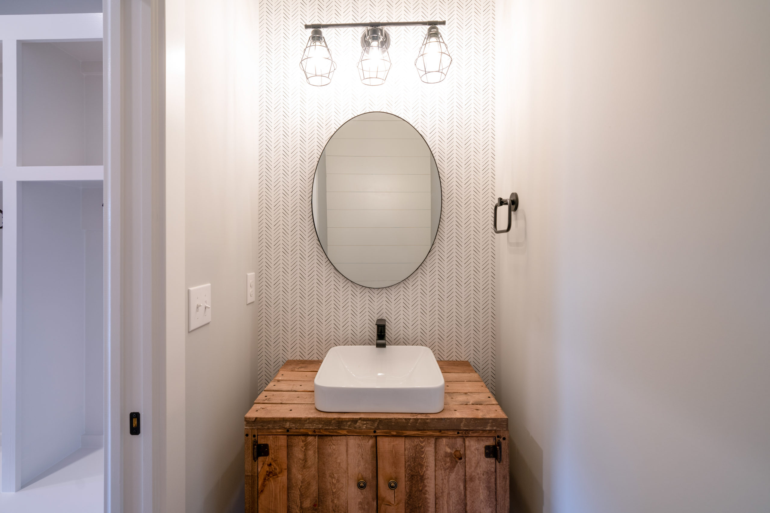 farmhouse powder room with custom wood vanity