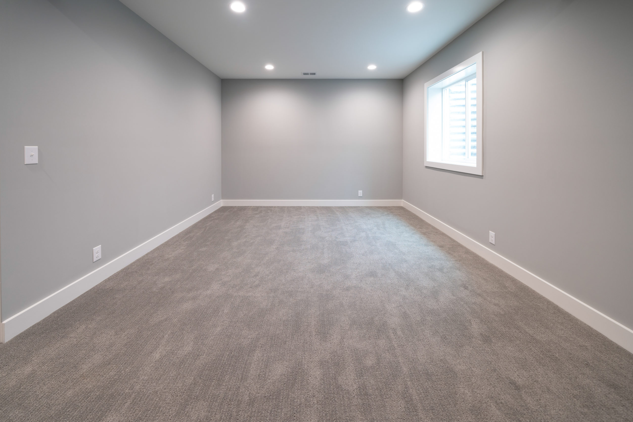 concrete flooring in finished basement