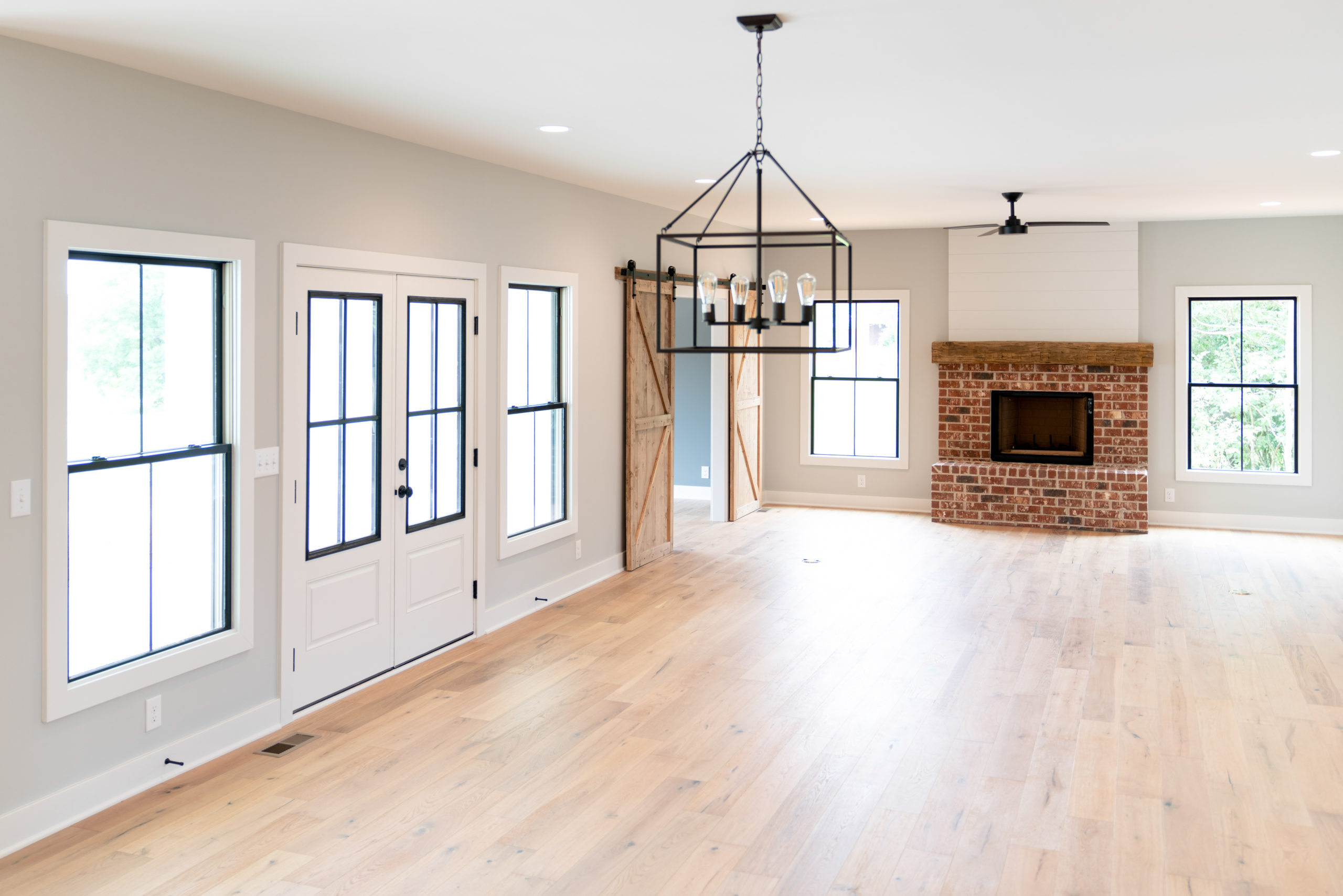 farmhouse living room with red brick fireplace