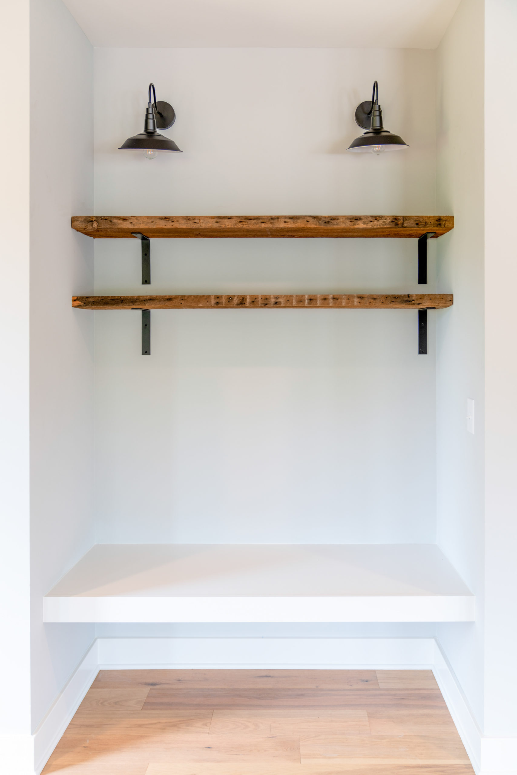 custom built in bench with custom wood shelving and sconces