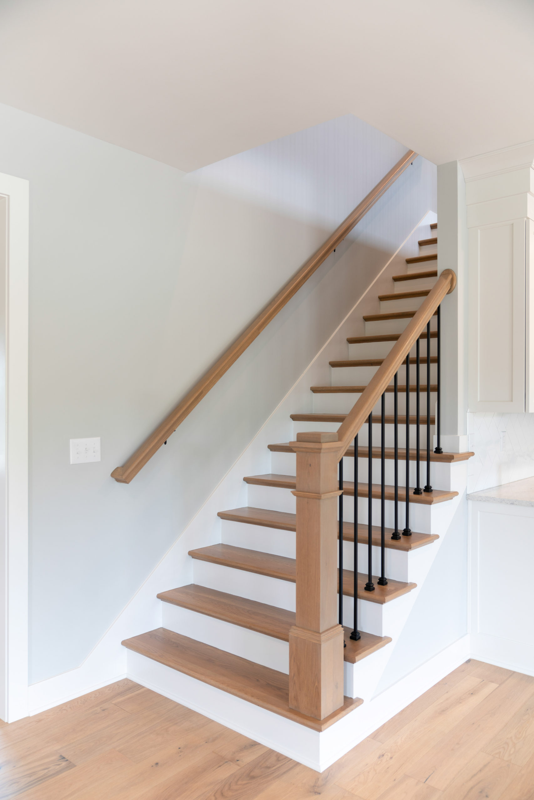 staircase in custom farmhouse