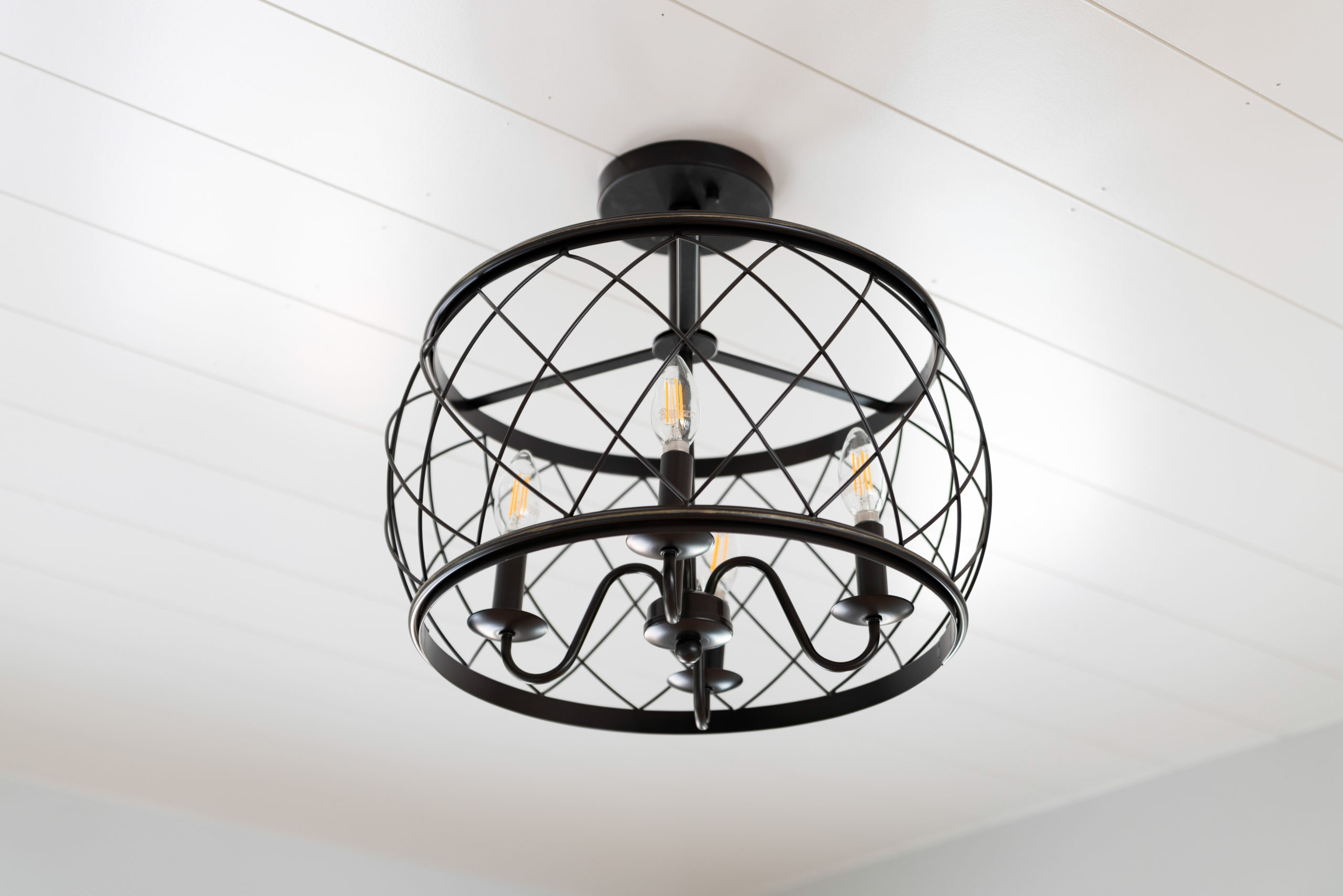 shiplap ceiling with farmhouse chandelier