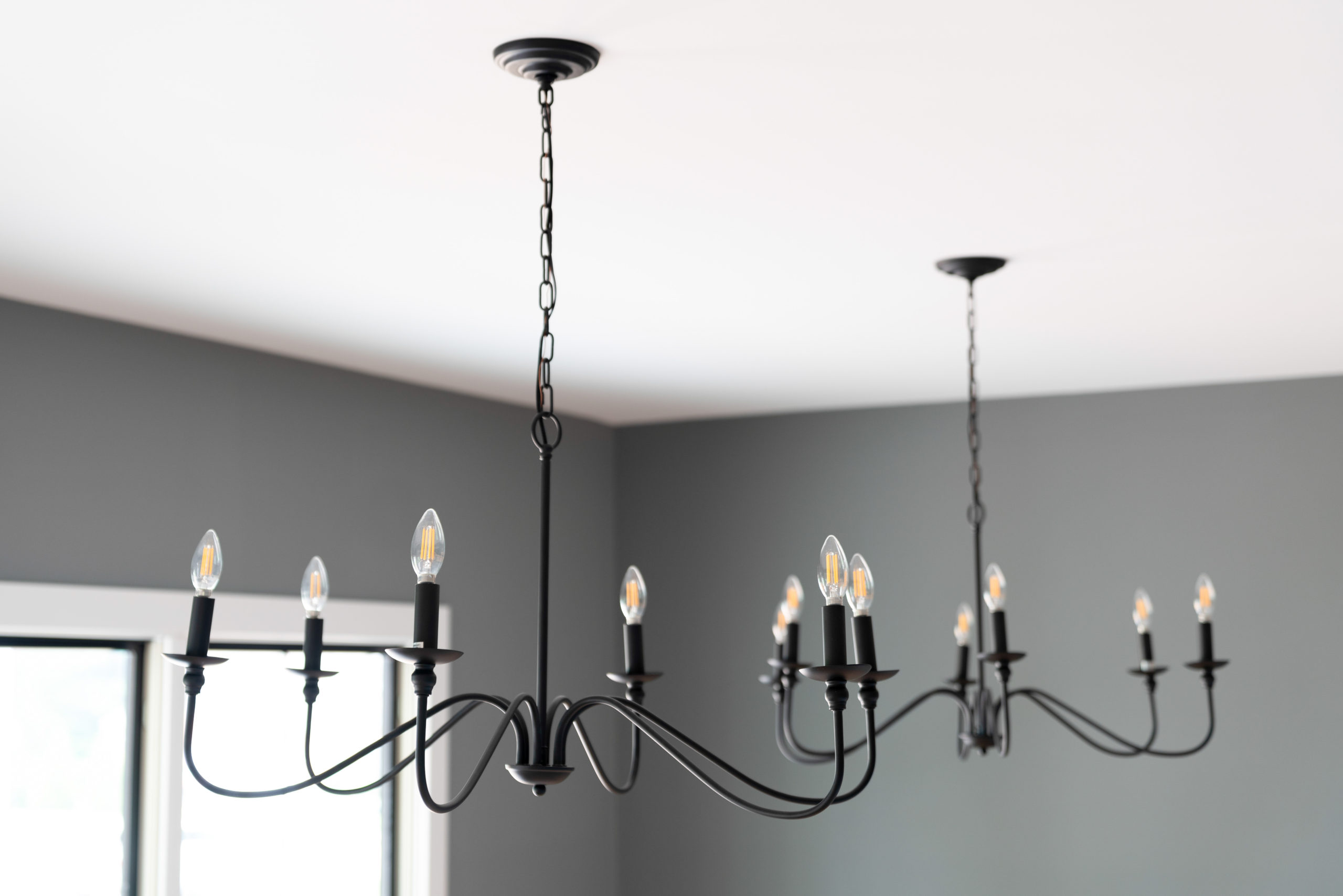 chandeliers in farmhouse dining room