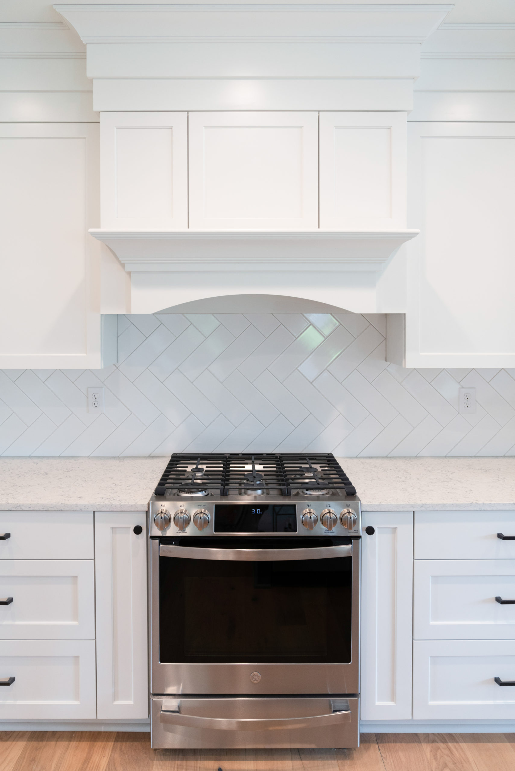 white cabinetry and white tile in farmhouse kitchen