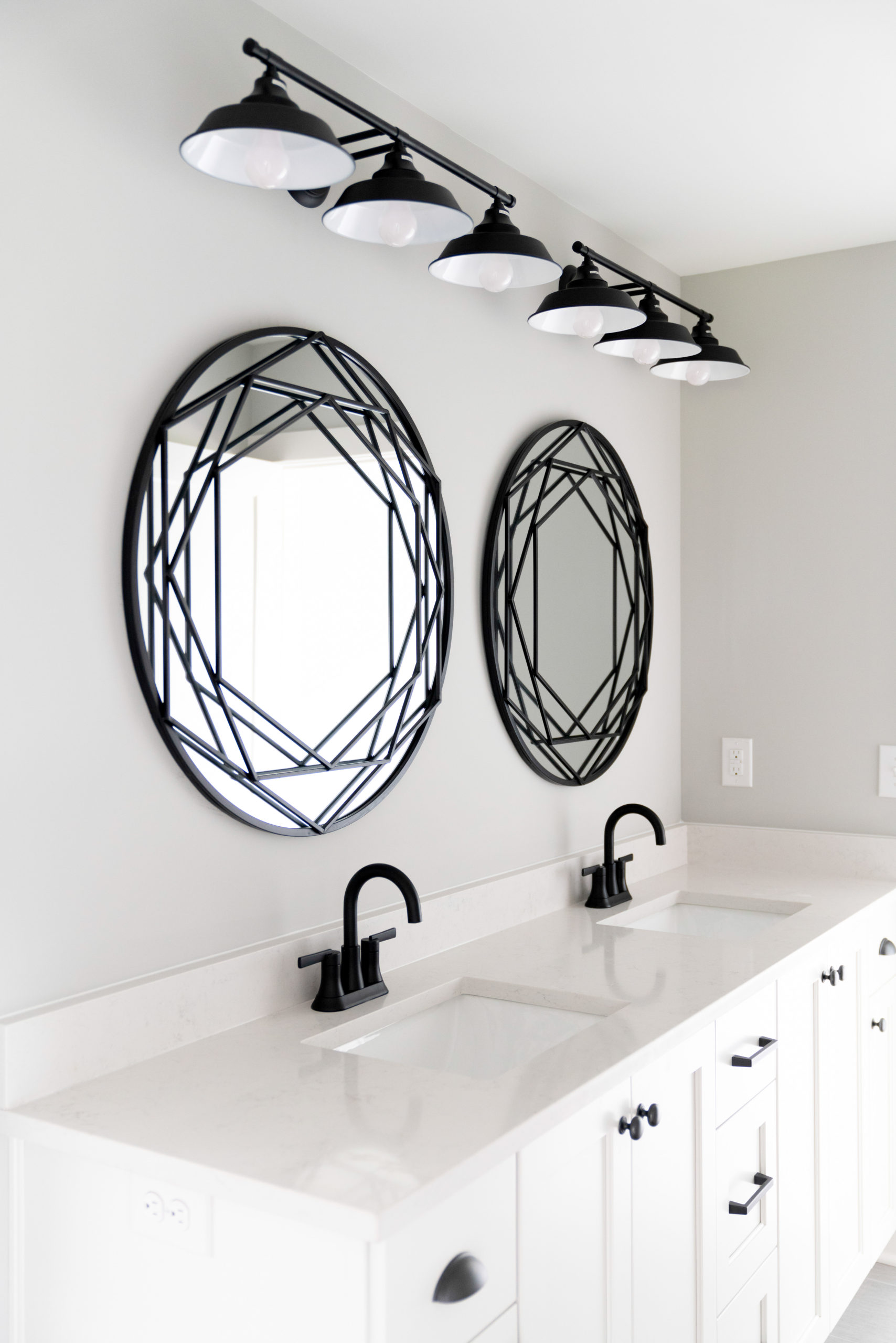 black and white double vanity with custom mirrors