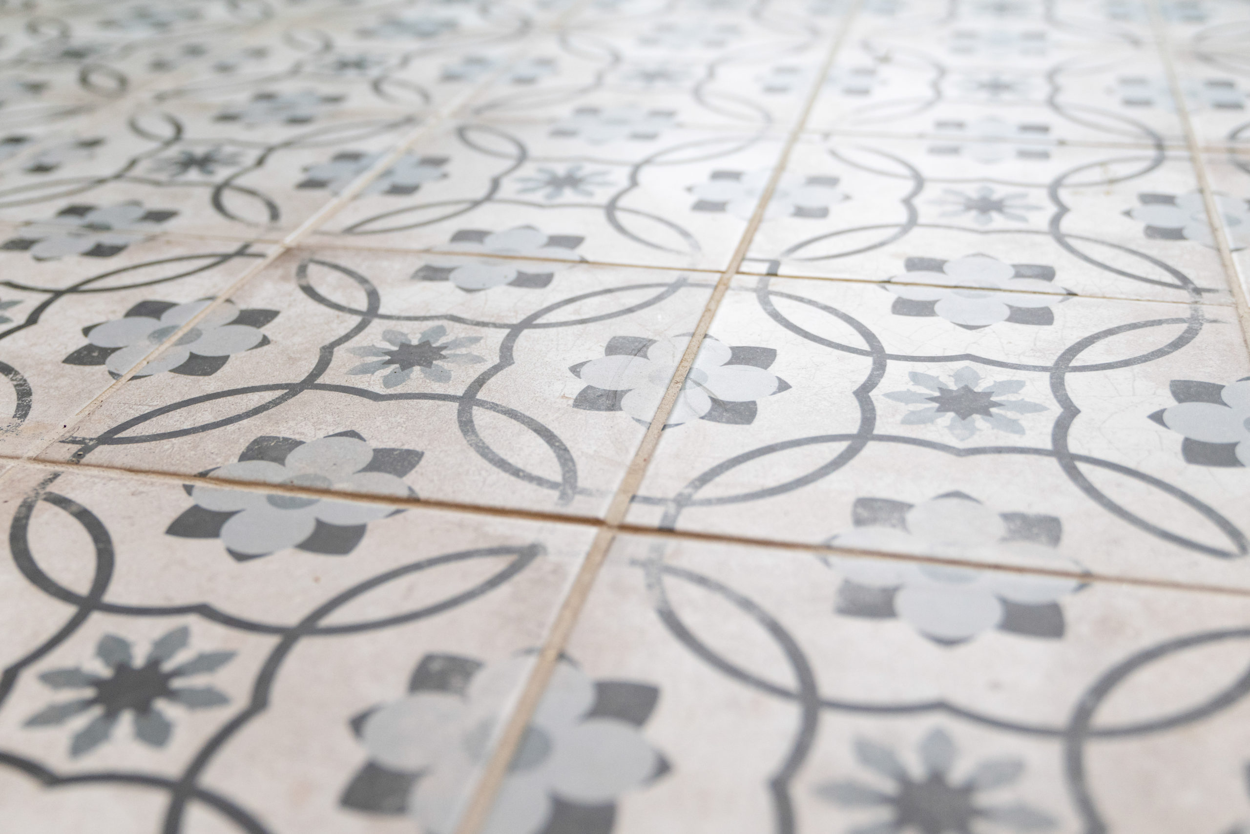 blue and white tiled floors in farmhouse laundry room