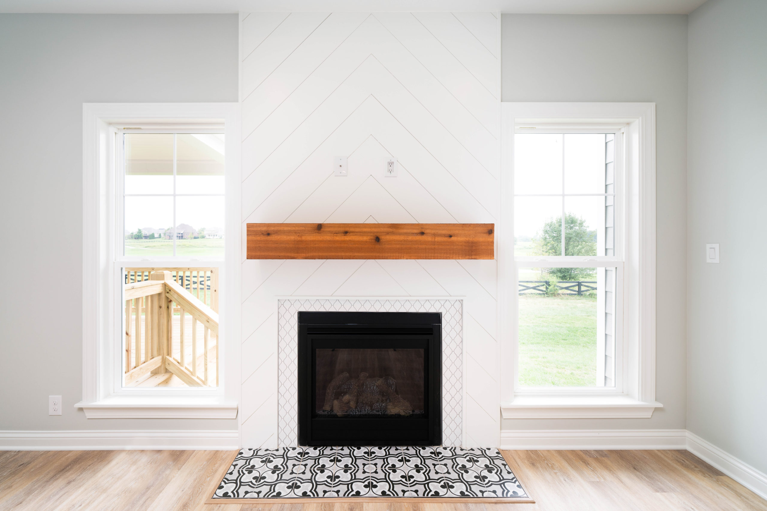 custom shiplap fireplace with tile floor and wood mantel