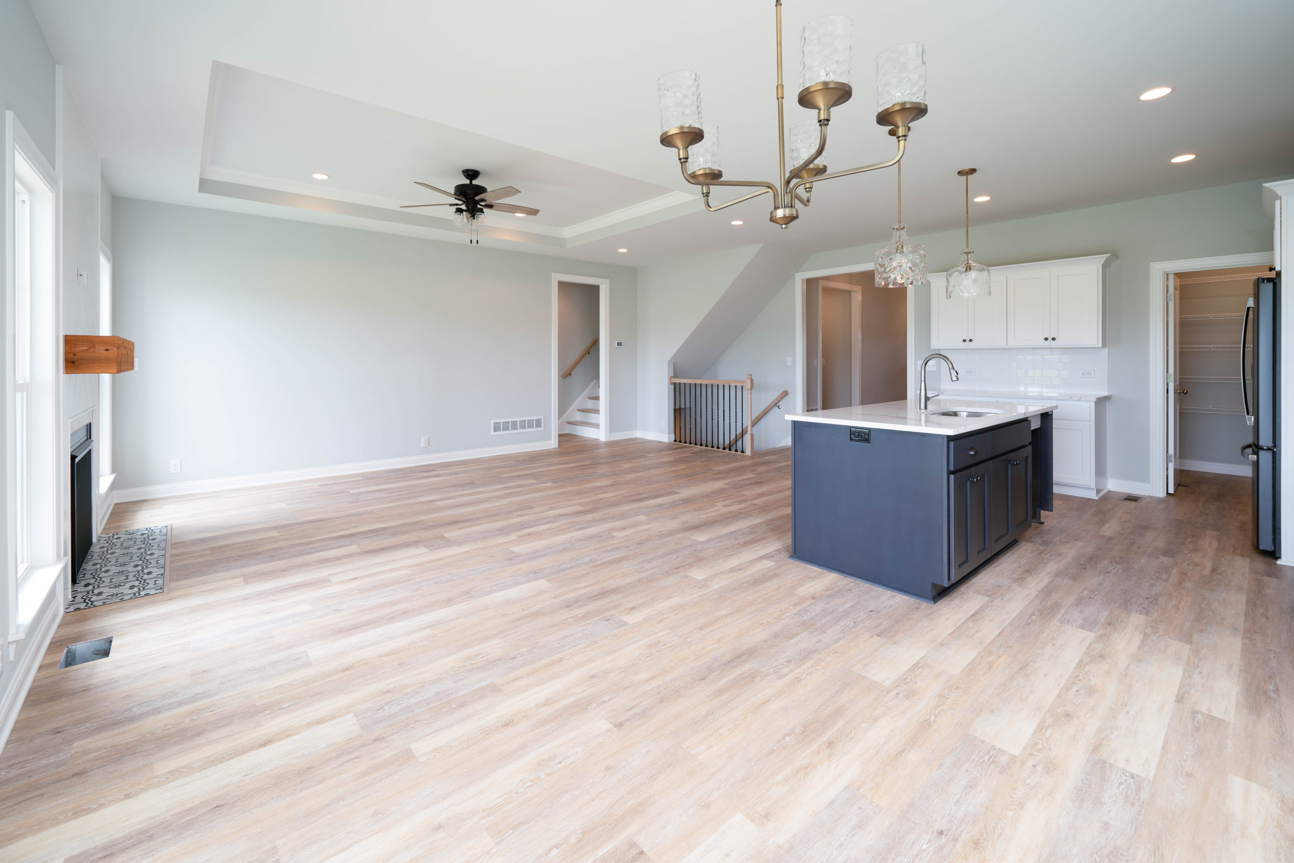 open concept living room and kitchen with light hardwood floors