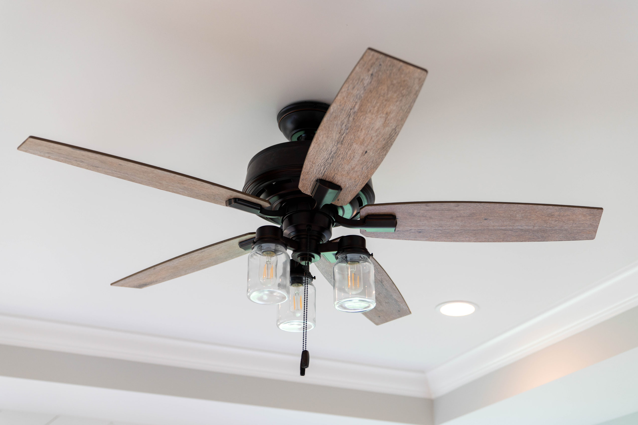 black metal and light hard ceiling fan on tray ceiling