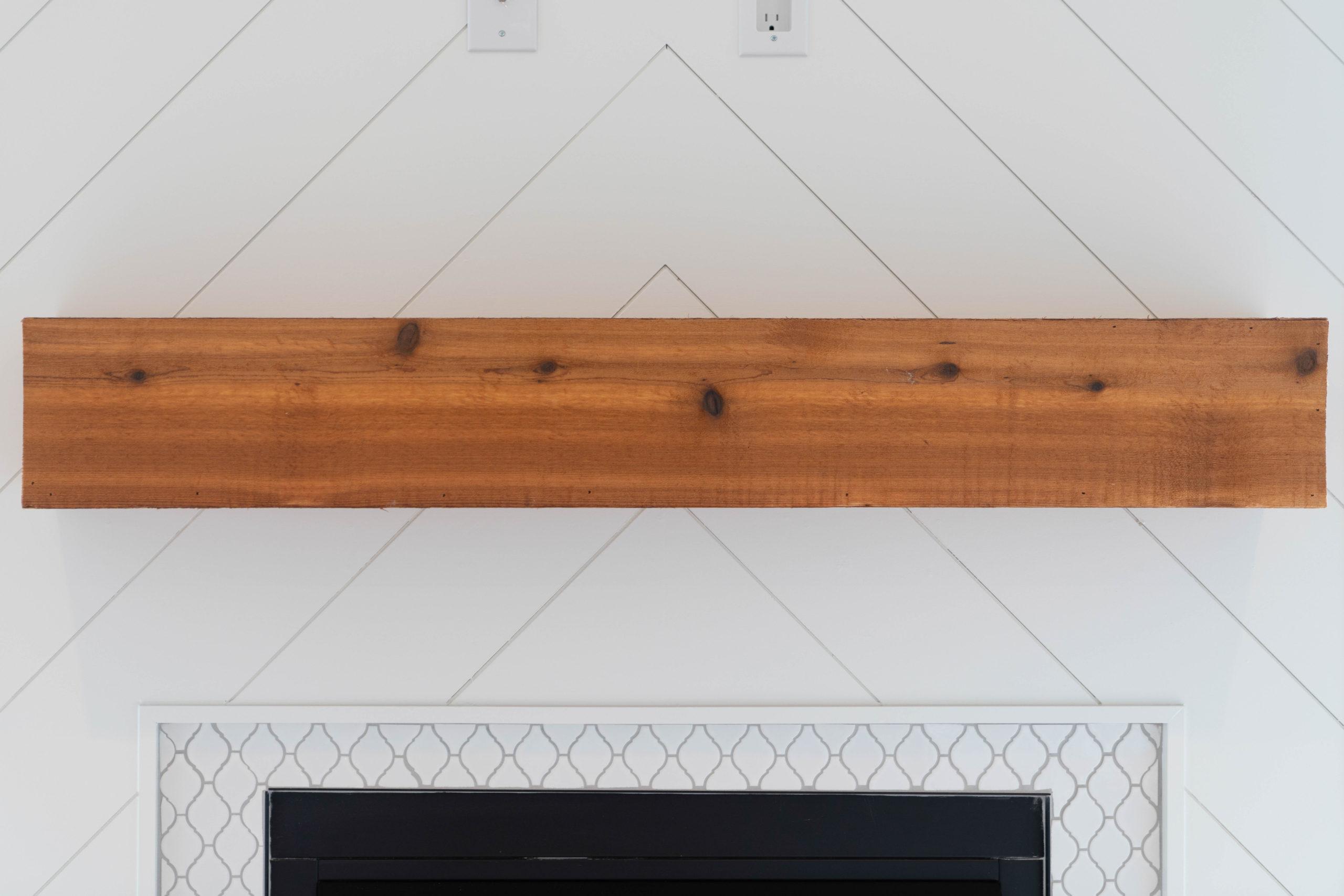 chevron white shiplap fireplace design with wood mantel