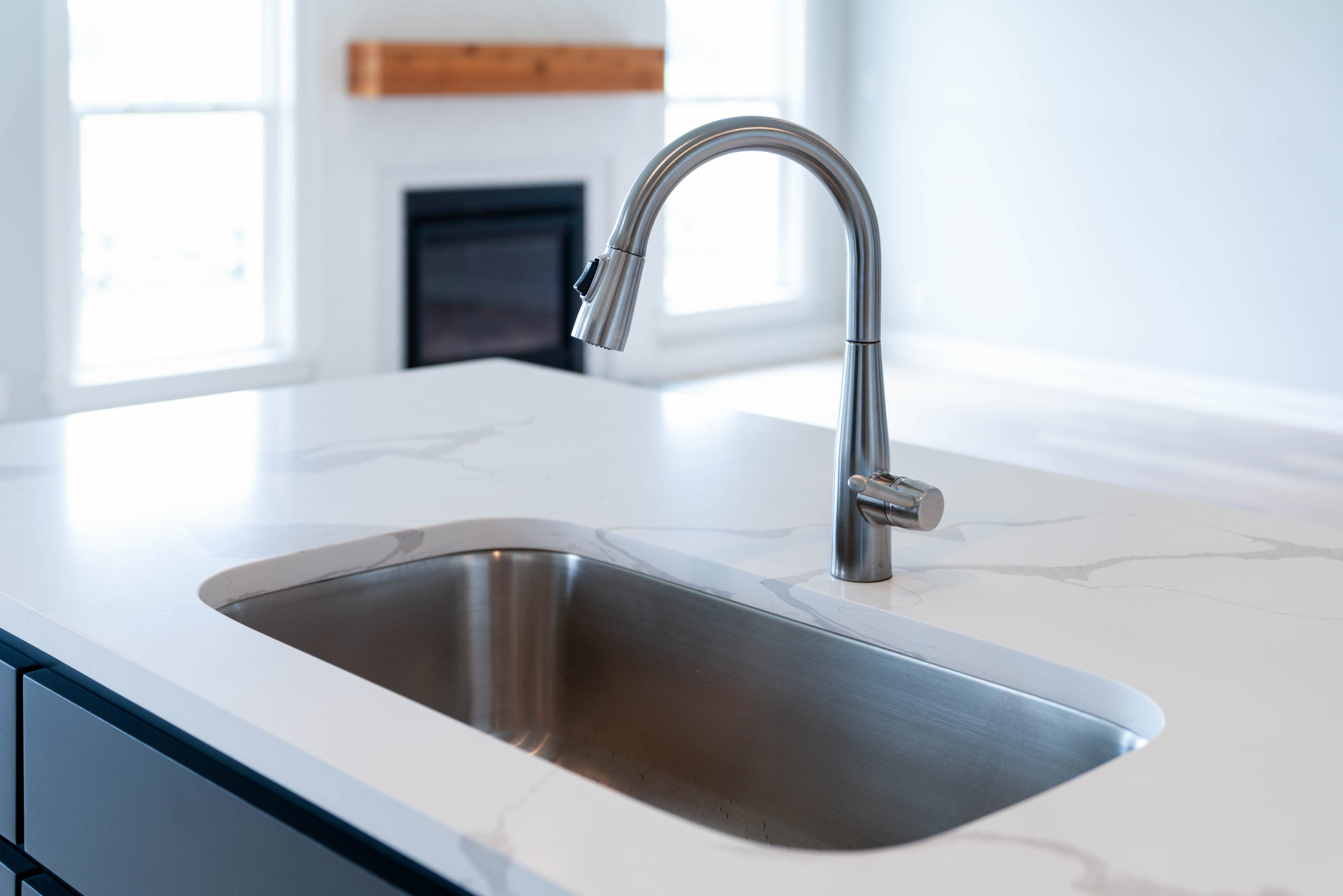 double kitchen sink in kitchen island with white marble countertop