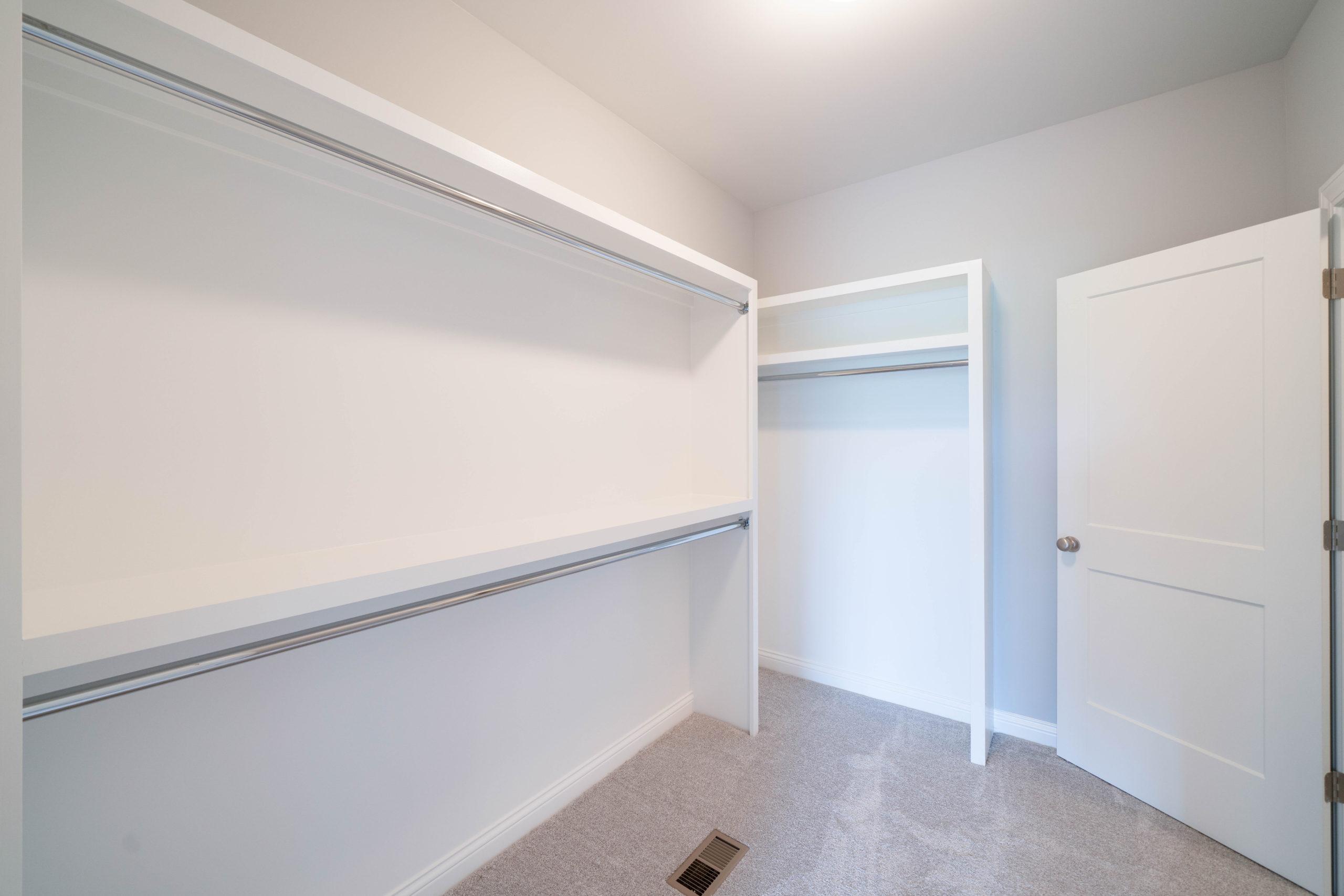 custom walk in closet with white