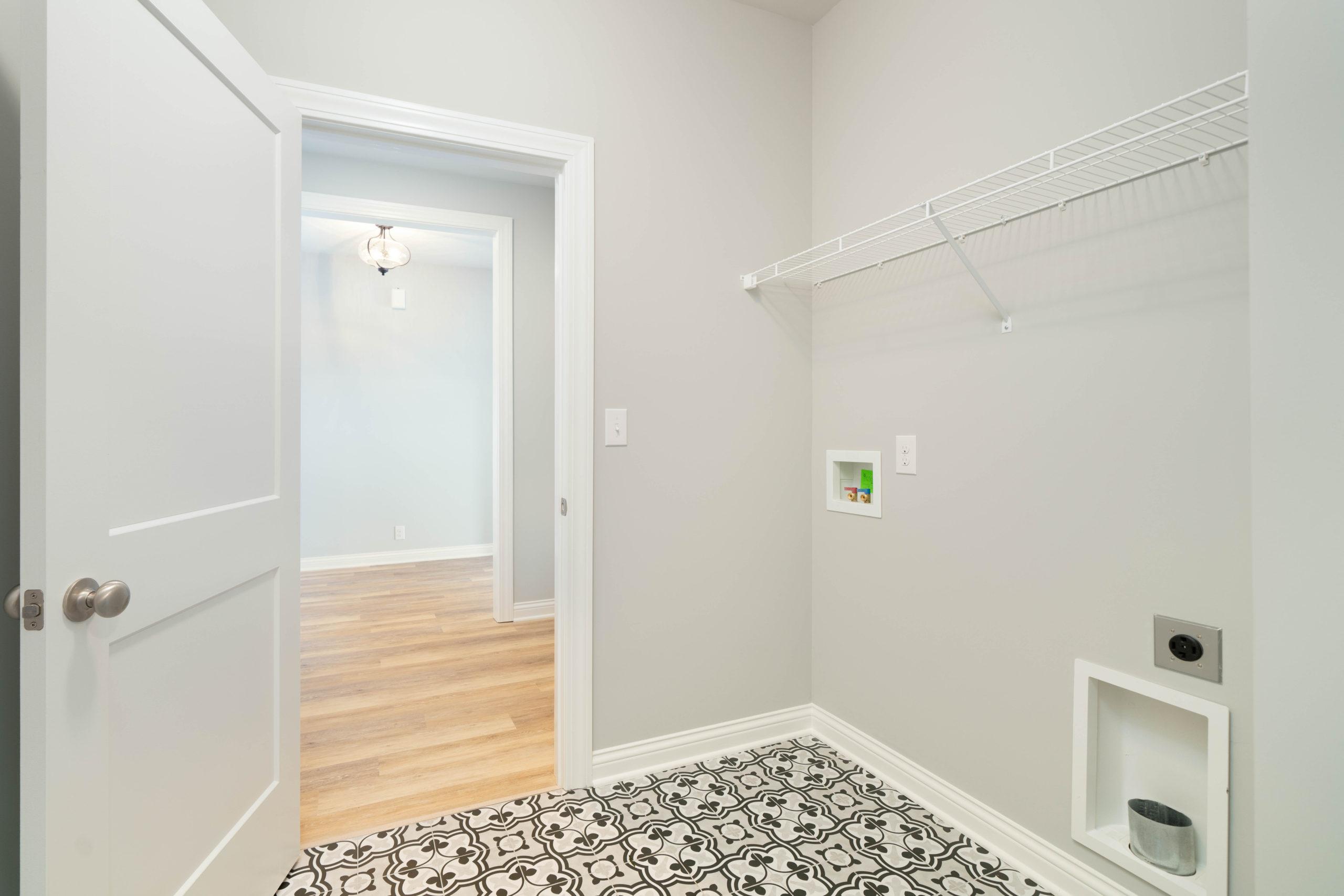 geometric tile floors in laundry room