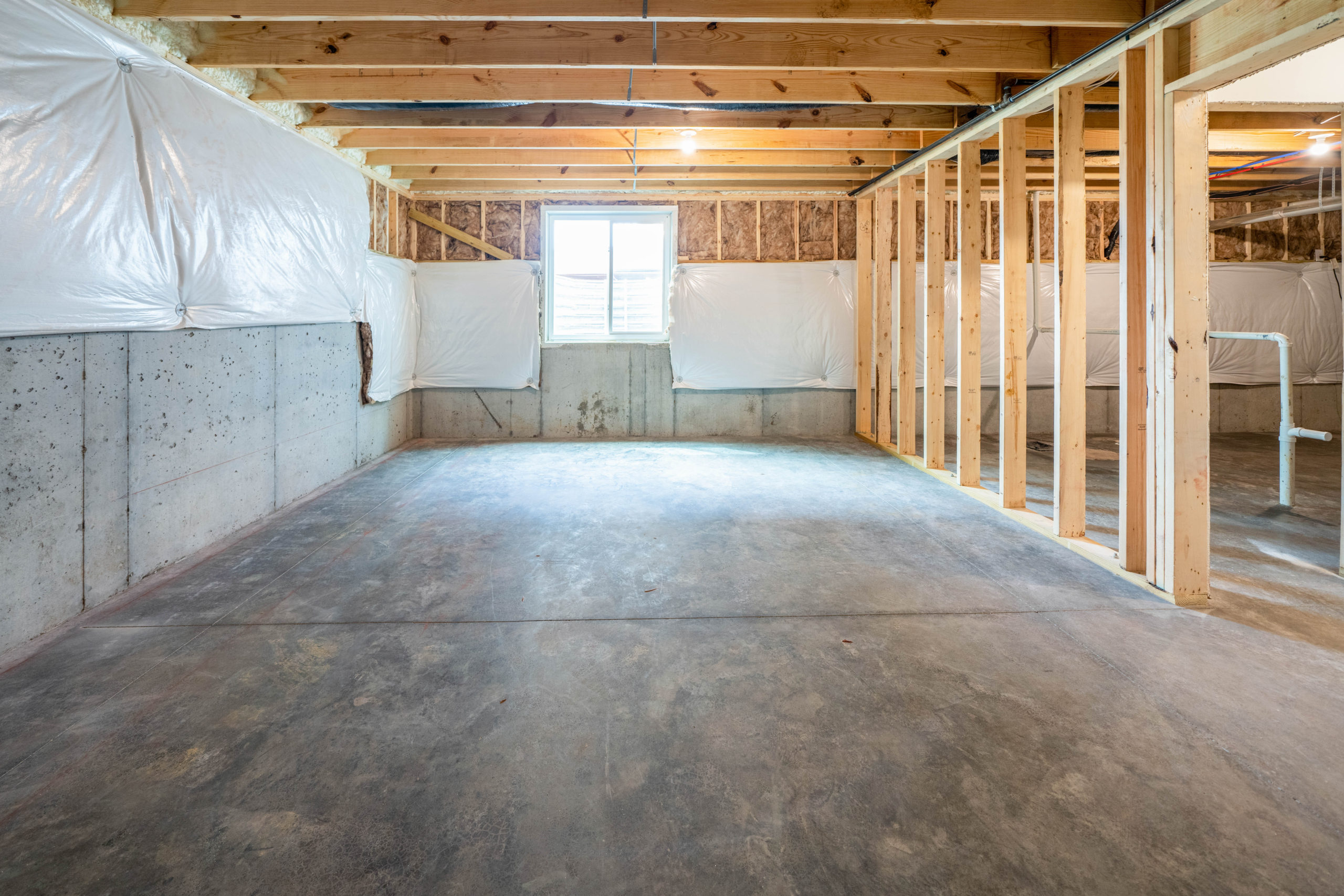 large unfinished basement with concrete flooring