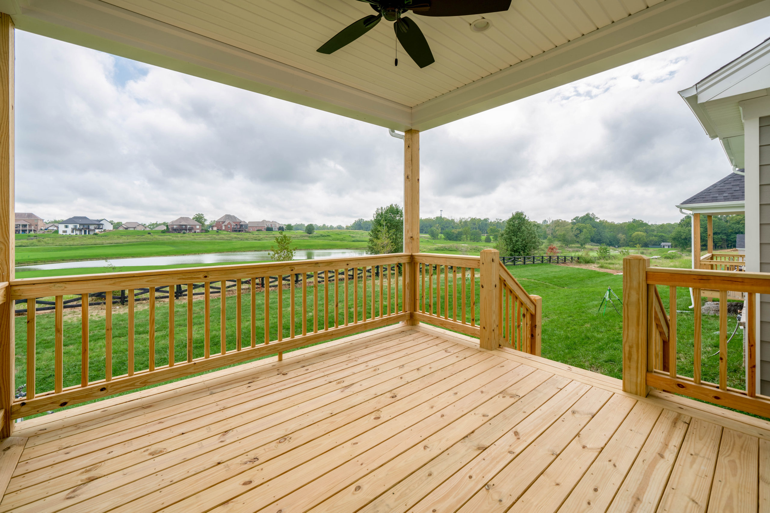back porch with ceiling fan