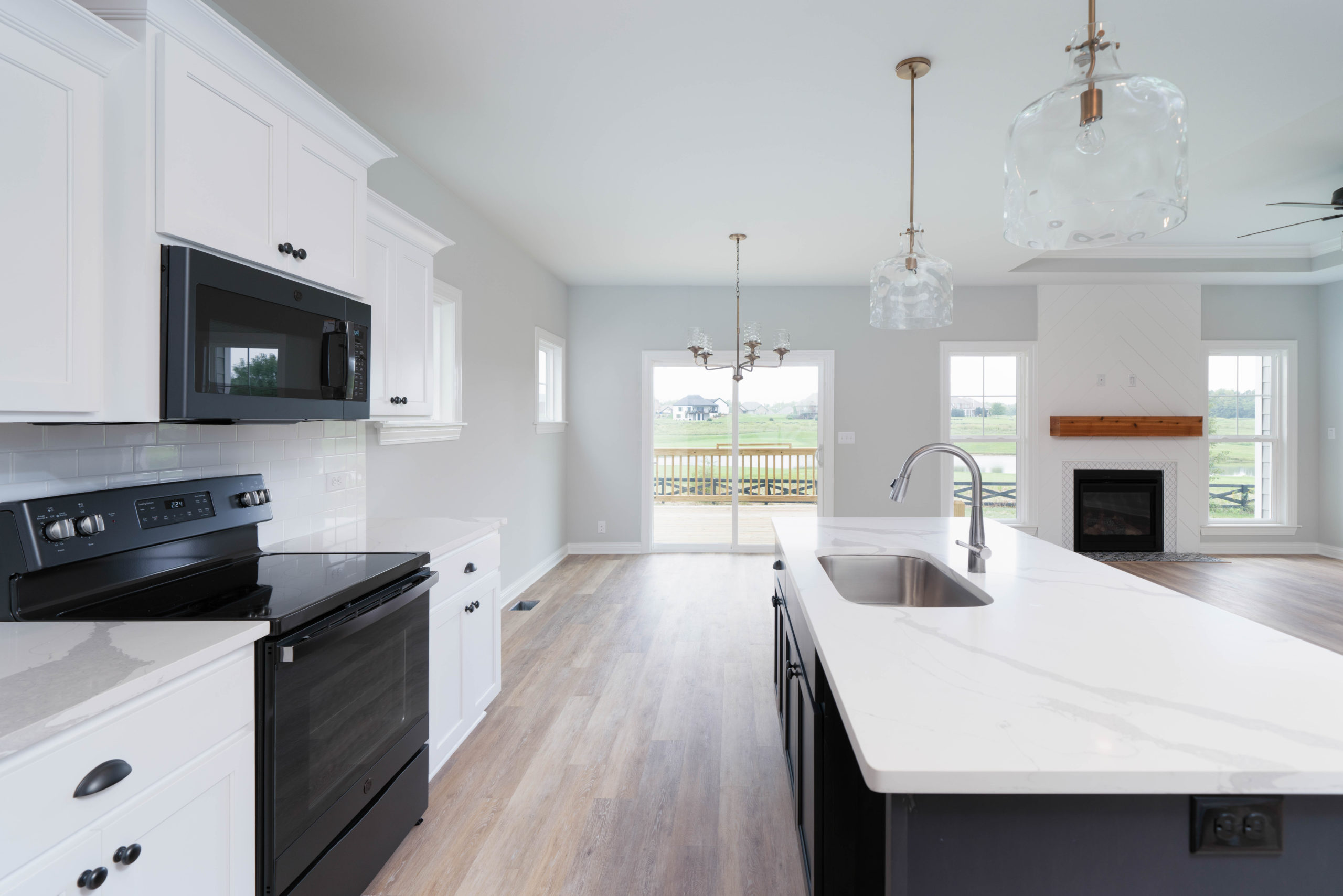 black and white custom kitchen with hardwood floors